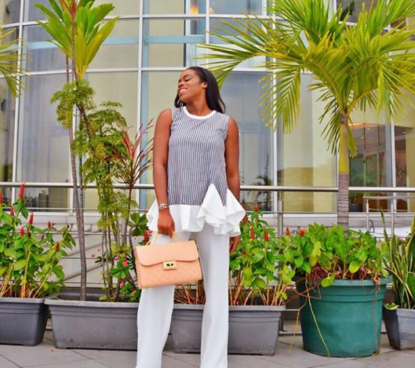 stripped blouse and wide leg pants with cream purse