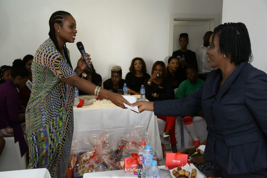 Mrs. Oke Maduewesi presenting the widows with cheques