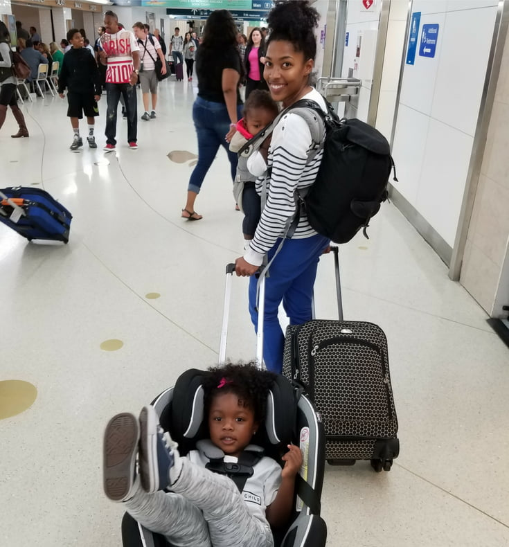 mother with kids and a carryon